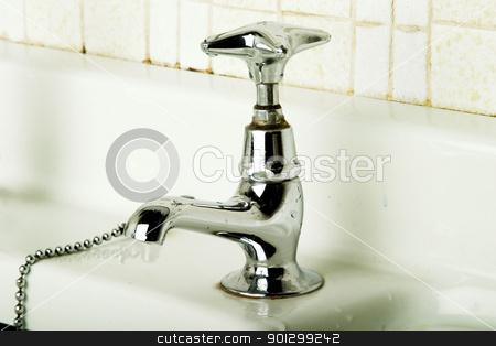 Retro Tap stock photo, A retro bathroom sink tap. by Tyler Olson