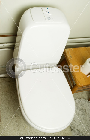 European Toilet stock photo, An interior shot of a european bathroom showing the toilet by Tyler Olson