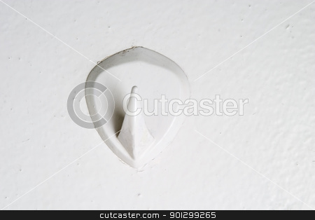 Retro Hook stock photo, A retro bathroom hook stuck on the wall from the 1970's era. by Tyler Olson