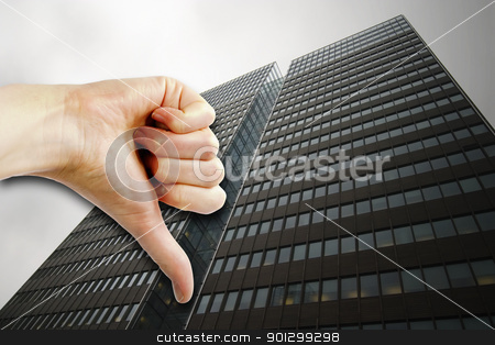 Poor Business stock photo, A thumbs down sign with a tall building in the background. by Tyler Olson