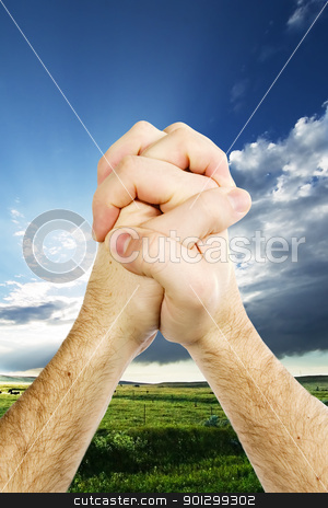 Thanksgiving stock photo, A pair of hands giving thanks on the prairie landscape by Tyler Olson