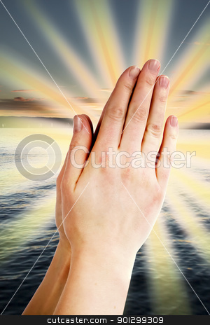 Power of Prayer stock photo, Praying hands with a landscape with the ocean and a sunset in the background. by Tyler Olson