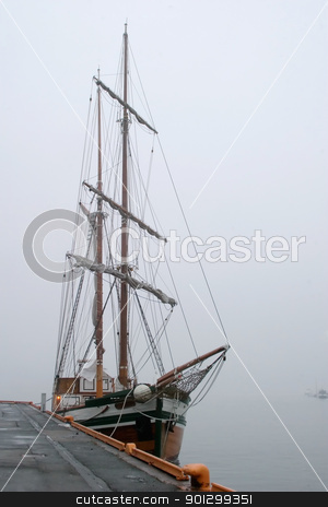 Pirate Ship in Fog stock photo, An old wooden sail ship in thick fog. by Tyler Olson