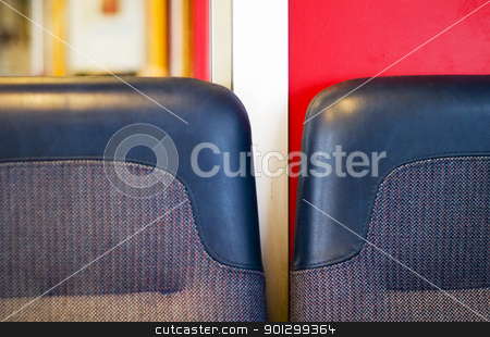 Train Seat Abstract stock photo, A train seat abstract with dominant blue and red colors. by Tyler Olson