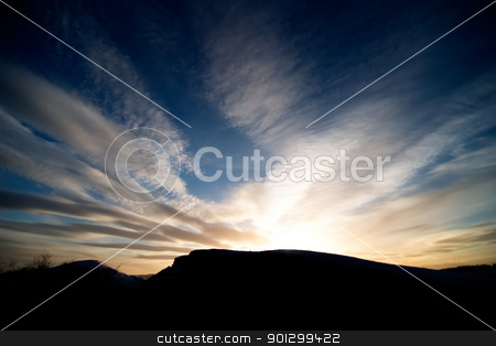 Rock and Ocean Sunset stock photo, A rock landscape near the ocean during a sunset and a dramatic sky. by Tyler Olson