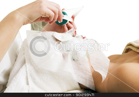 Facial Mask Detail stock photo, Lotion being applied to the face during a facial mask at a beauty spa. by Tyler Olson