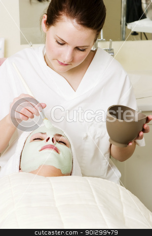 Facial Mask stock photo, A detail image of a green apple mask being applied at a beauty spa. by Tyler Olson