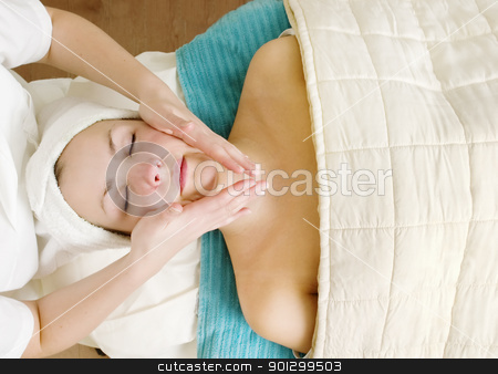Facial Massage stock photo, A woman receiving a facial massage at a beauty spa. by Tyler Olson