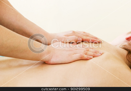 Shoulder Massage Luxury stock photo, A female receives a shoulder massage at a day spa. by Tyler Olson