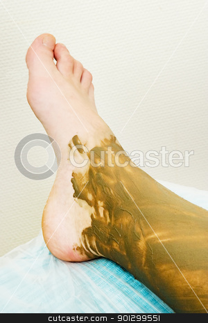 Full Body Wrap stock photo, A detail image of a sea mud full body wrap at a luxury spa. by Tyler Olson