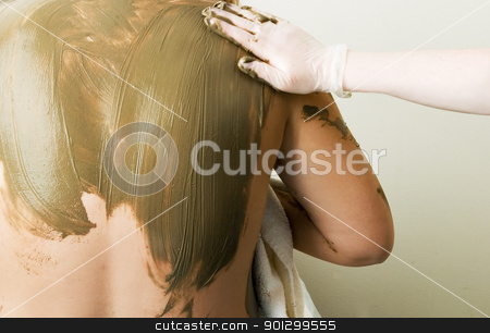 Full Body Wrap stock photo, A sea mud full body wrap at a luxury spa being applied to the back and shoulders. by Tyler Olson