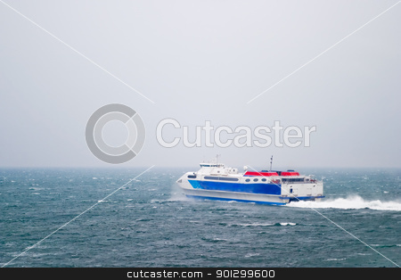 Speed Ferry on Ocean stock photo, A speed ferry catamaran on the Ocean by Tyler Olson