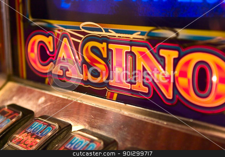 Slot Machine Detail stock photo, detail image of slot machine displaying the word casino. by Tyler Olson