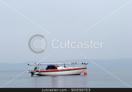 Sailboat on Ocean stock photo, A sailboat in the mist on the ocean by Tyler Olson