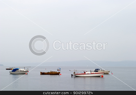 Sailboats on Ocean stock photo, Oslo fjord with sail boats in the mist by Tyler Olson