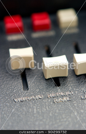 Vibrato Slider Detail stock photo, Retro organ slider details with focus on vibrato and repeat rate by Tyler Olson