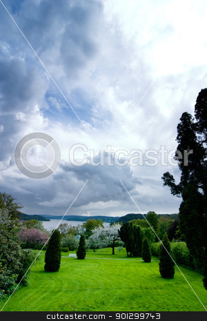 Park with Dramatic Sky stock photo, A beautiful park or garden with a dramatic sky in the background by Tyler Olson