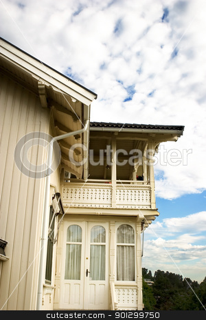 Wooden Swiss Villa stock photo, An old swiss style villa in south eastern norway against a blue sky with clouds. by Tyler Olson