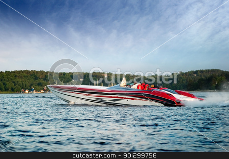 Luxury Speedboat stock photo, A very large speedboat crusing on a lake. by Tyler Olson