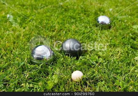 Bocce Balls stock photo, Bocce balls sitting in the green grass, close to the target. -shallow depth of field.- by Tyler Olson