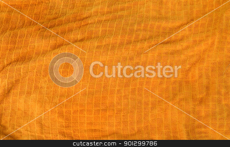 Orange Towel Texture stock photo, A bright orange cloth towl background texture by Tyler Olson