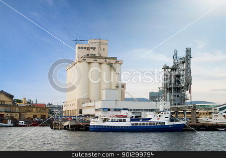 Seaside Port stock photo, An ocean seaside port with a grain terminal and ferry by Tyler Olson