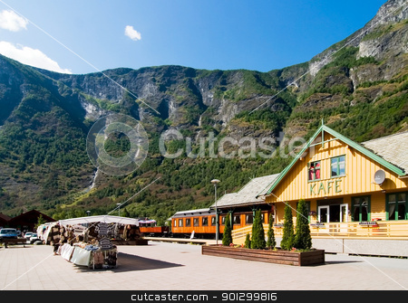 Mountain Town in the Fjords stock photo, The small tourist town of Flam (flm) on the western side of Norway deep in the fjords.  The flm railway station and aurlandsfjord are in view. by Tyler Olson