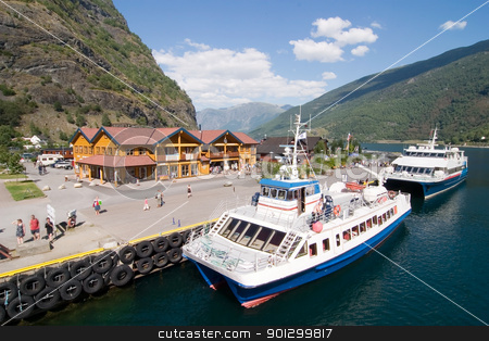 Mountain Town in the Fjords stock photo, Docks in the small tourist town of Flam (flm) on the western side of Norway deep in the fjords by Tyler Olson