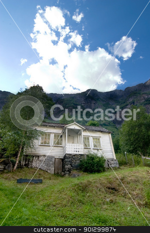 Mountin House stock photo, Mountains looming over a house in rural Norway by Tyler Olson
