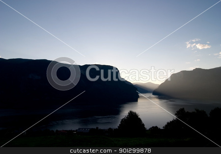 Evening Fjord View stock photo, Fjord in western Norway as the sun goes down - great copyspace in the bottom area, or sky. by Tyler Olson