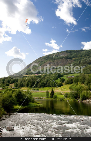 Norwegian Mountain with Parachute stock photo, A Norwegian mountain landscape with a parachute in the sky by Tyler Olson