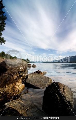 Norwegian Fjord Landscape stock photo, view over a norwegian fjord with a big sky by Tyler Olson