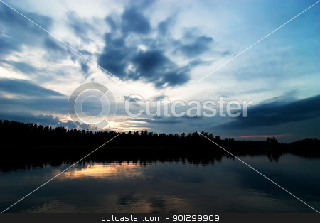 Lake Silhouette stock photo, A lake in the evening with a dramtic sky with clodus by Tyler Olson