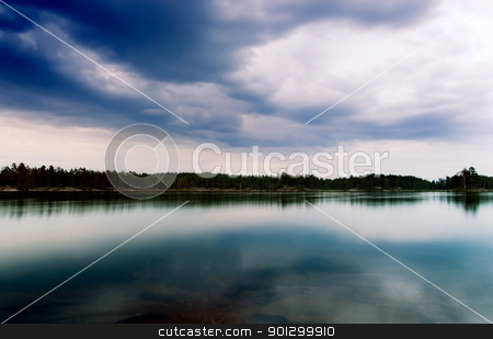 Lake Landscape stock photo, A dramatic image of a lake with vivid clouds by Tyler Olson