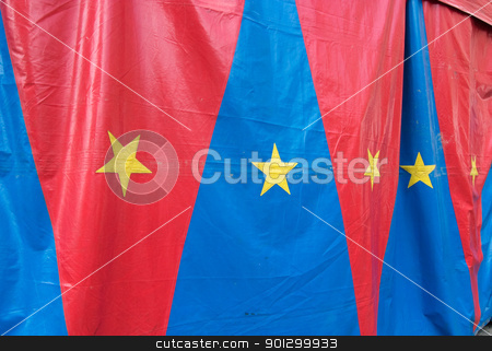 Circus Tent stock photo, A circus tent with red and blue triangles and yellow stars. by Tyler Olson