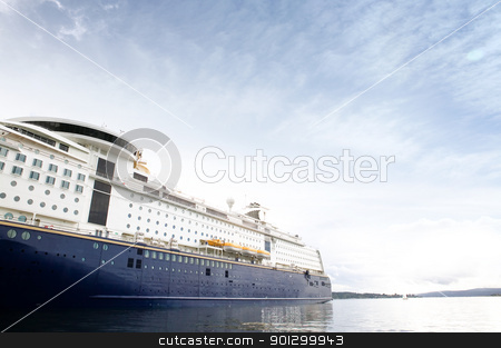 Cruise Ship stock photo, A cruise ship at dock against a blue sky by Tyler Olson