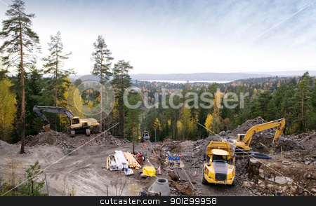 Contruction Equipment stock photo, Construction equipment on the side of a mountian, preparing the ground for a building. by Tyler Olson