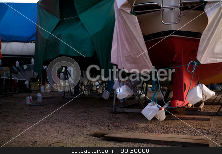 Winter Boat Storage stock photo, Boats on dry land being stored for the winter months. by Tyler Olson