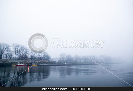 Thick Fog over Water stock photo, A river edge in thick fog during the winter. by Tyler Olson