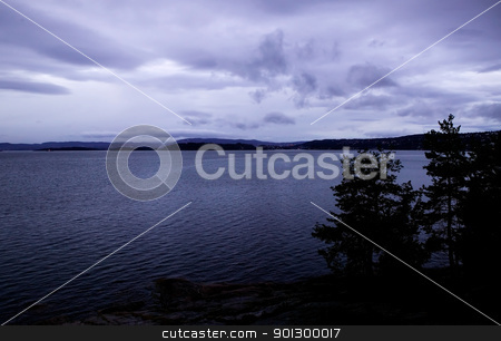 Moody Seascape stock photo, A dark purple tinted moody seascape from Norway by Tyler Olson