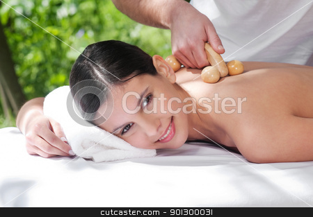 Young woman getting massage by a therapist stock photo, Beautiful young woman getting massage by a therapist by Tyler Olson