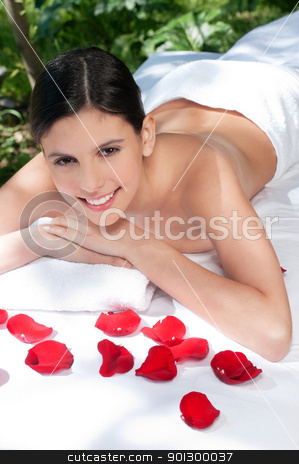 Beautiful young woman relaxing stock photo, Smiling young woman relaxing at spa in a natural setting by Tyler Olson