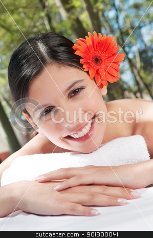 Girl with flower in her hair stock photo, Portrait of a happy girl with flower in her hair by Tyler Olson