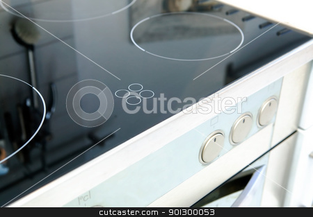 Ceramic Stove Top stock photo, A ceramic stove top with an oven in stainless steel. by Tyler Olson