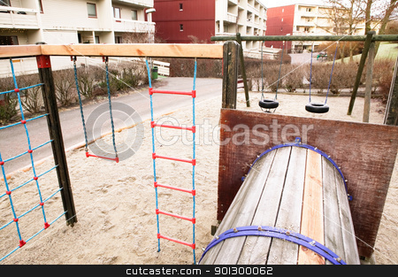 Playground near Apartments stock photo, A local playground amoungst some apartment buildings. by Tyler Olson