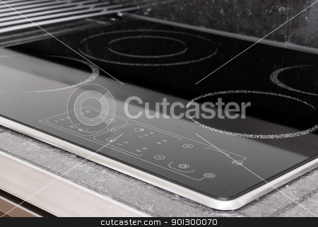 Induction Stove Detail stock photo, A modern induction stove detail by Tyler Olson