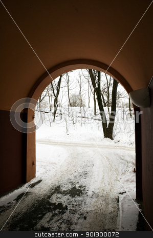 Arched Port stock photo, An arched driveway into a building by Tyler Olson