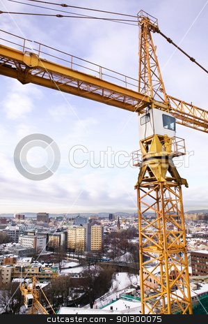 Crane Detail stock photo, A detail of a crane overlooking the Oslo fjord and city of Oslo. by Tyler Olson