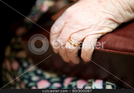 Old Hand stock photo, A detail of an old womans hand on her purse by Tyler Olson
