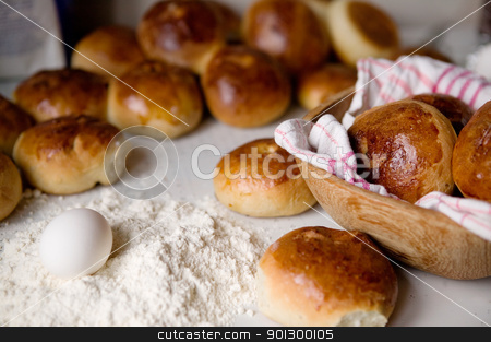 Hot Cross Buns stock photo, Close up detail of freshly baked hot cross buns and a few ingredients in romantic renaissance lighting and a shallow depth of field. by Tyler Olson